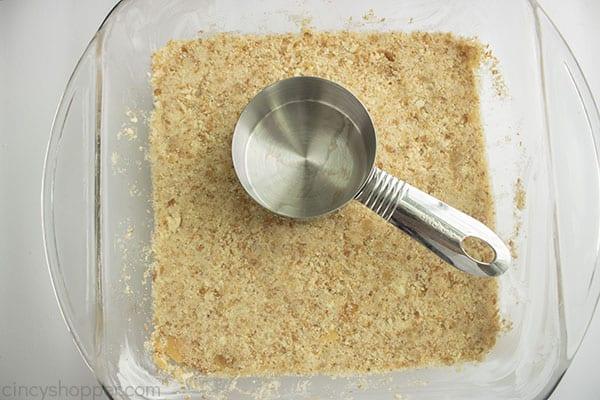 Pressing cookie mixtures in dish