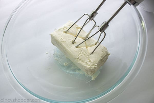 Beating the cream cheese for dip
