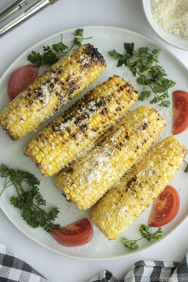 Parmesan Grilled Corn on the cob with garlic on a plate