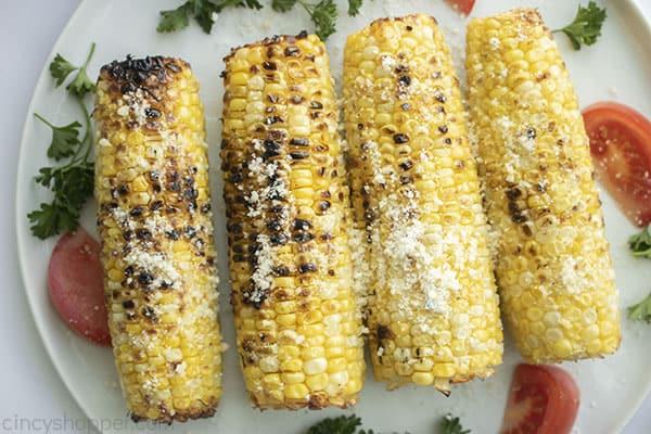 Seasoned corn on the cob grilled