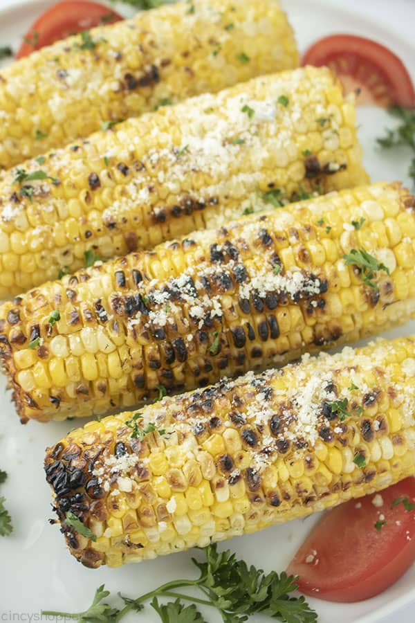 Fresh grilled corn with Parmesan on a plate