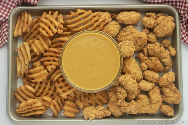 Sheet pan with chicken and waffle fries and CopyCat Chick-fil-A Sauce
