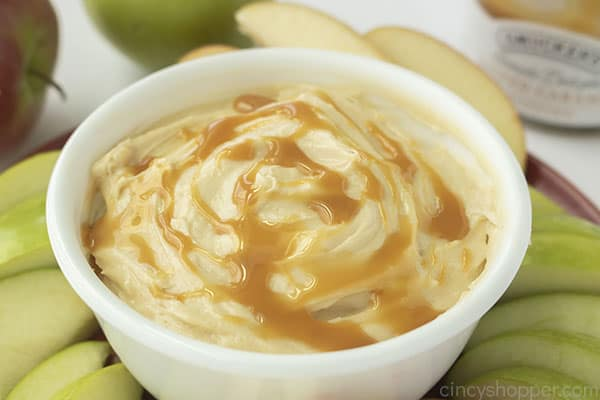 Cream cheese apple dip with caramel in a bowl